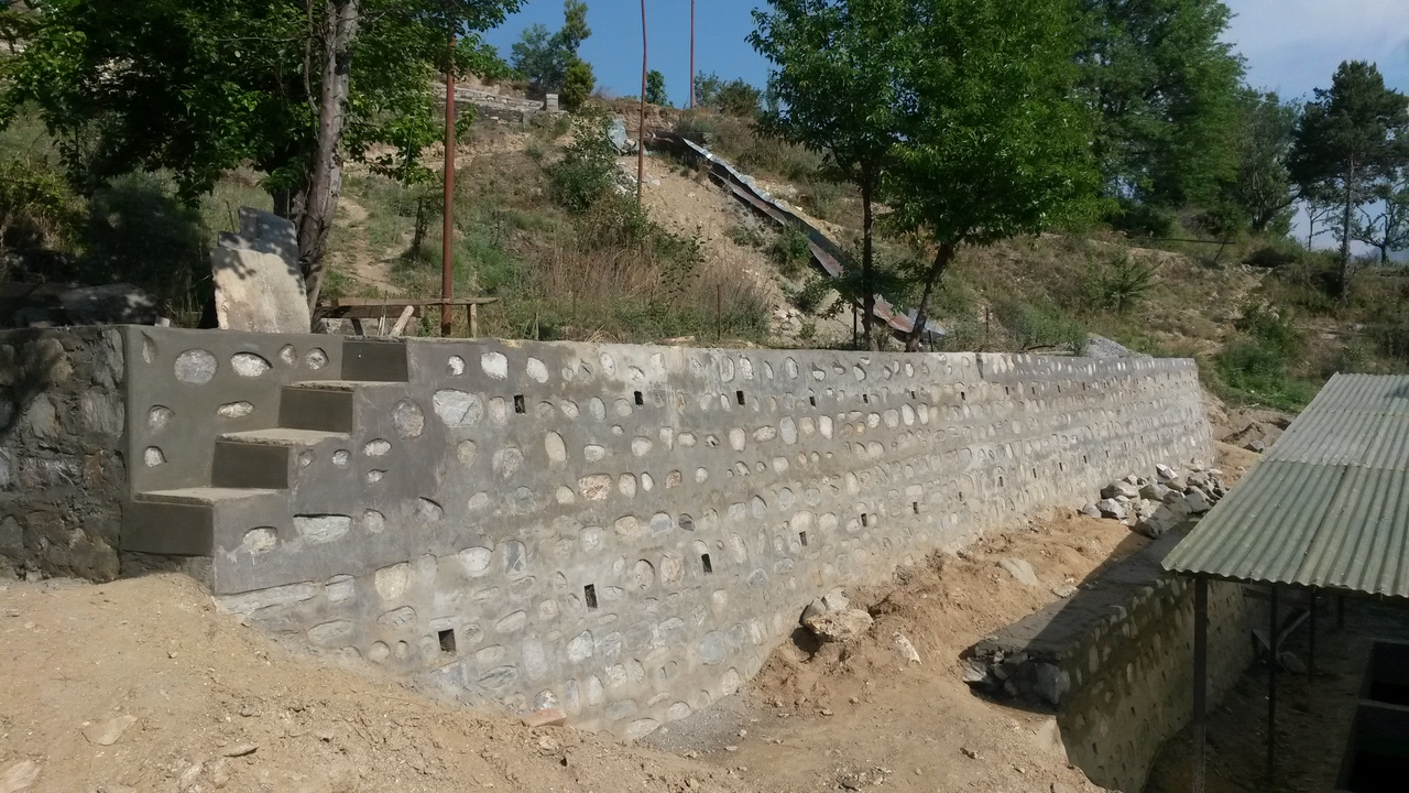Back retaining wall nearly complete